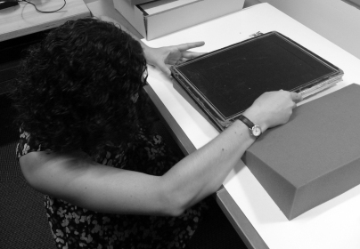 Preparing a late 19th-century Japanese photograph album for cataloging at the Weissman Preservation Center.