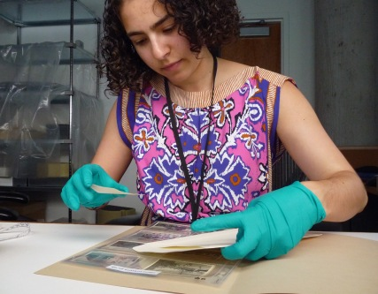 Rehousing and cataloging african photograph collections at the Weissman Preservation Center.