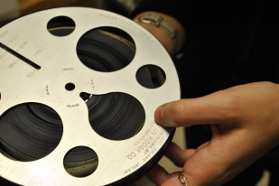 Surveying acetate motion picture film at the University of Michigan Museum of Anthropology.